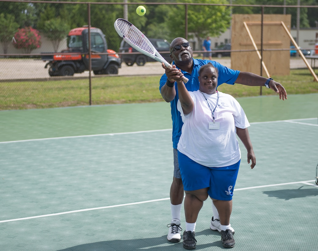 Henry Harris, Special Olympics Mississippi tennis director, helps Lashandra Woods, Area 7 athlete, during the Special Olympics Mississippi 2017 Summer Games at the tennis courts May 20, 2017, on Keesler Air Force Base, Miss. Founded in 1968, Special Olympics hosts sporting events around the world for people of all ages with special needs to include more than 700 athletes from Mississippi.  (U.S. Air Force photo by Andre' Askew)