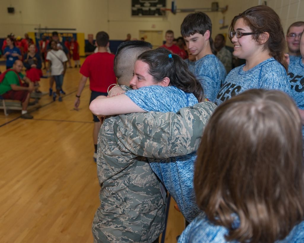 Brandon Pangilinan, 333rd Training Squadron student, presents Area 16 athletes with medals after the volleyball competition during the Special Olympics Mississippi 2017 Summer Games at the Blake Fitness Center May 20, 2017, on Keesler Air Force Base, Miss. Keesler hosted more than 3,200 athletes, directors, coaches, family members and volunteers spanning over 16 regions across Mississippi for the 31st year. (U.S. Air Force photo by Andre' Askew)
