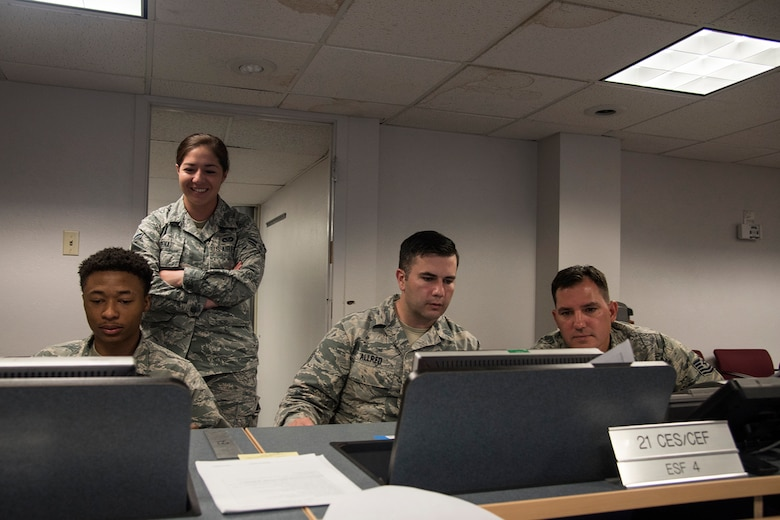 PETERSON AIR FORCE BASE, Colo. – Airmen with the 21st Civil Engineer Squadron develop a logistics plan and review Air Force Instruction requirements for a beddown exercise during their monthly Prime Base Engineer Emergency Force day, May 18, 2017, at Peterson Air Force Base, Colo. Approximately 100 21st CES Airmen participated in Prime BEEF day, completing a beddown exercise for a scenario involving 2500 troops, 23 aircraft and operational space assets. The squadron was split up into two teams for the day: planning group and hands-on training. (U.S. Air Force photo by Staff Sgt. Tiffany Lundberg)