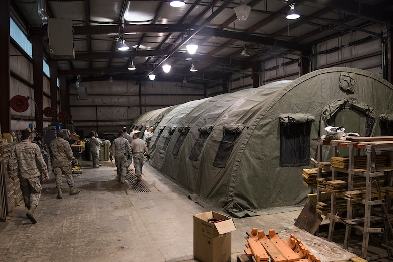 PETERSON AIR FORCE BASE, Colo. – Airmen with the 21st Civil Engineer Squadron set up two tents during a beddown exercise during their monthly Prime Base Engineer Emergency Force day, May 18, 2017, at Peterson Air Force Base, Colo. Approximately 100 21st CES Airmen came together for the Prime BEEF Day, to complete a beddown exercise. The squadron was split up into two teams for the day: logistics planning group and hands-on training. (U.S. Air Force photo by Staff Sgt. Tiffany Lundberg)