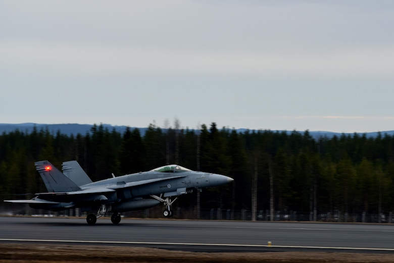 A Finnish F/A-18 Hornet takes off at Rovaniemi Air Base, Finland, May 22, in support of Arctic Challenge 2017. Through exercises such as ACE 17, U.S., allies and partner nations are able to build on their expertise in the air and create a force ready to respond to a crisis together. (U.S. Air Force photo/Airman 1st Class Abby L. Finkel)