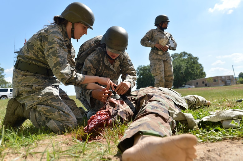 U.S. Airmen assigned to the 20th Medical Operations Support Squadron (MDOS) tend to a dummy patient during operational readiness exercise Weasel Victory 17-07 at Shaw Air Force Base, S.C., May 16, 2017. Airmen assigned to the 20th MDOS were tested on how quickly and efficiently they could care for injured casualties in a deployed or stateside environment. (U.S. Air Force photo by Airman 1st Class Christopher Maldonado)