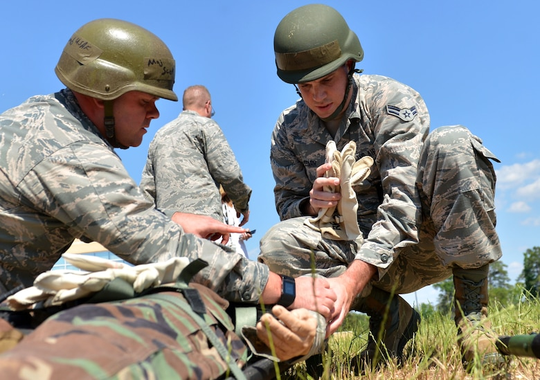 U.S. Airmen assigned to the 20th Medical Operations Support Squadron carry a simulated casualty to an evacuation site during operational readiness exercise Weasel Victory 17-07 at Shaw Air Force Base, S.C., May 16, 2017. After assessing and transporting victims, the Airmen were provided feedback by wing inspection team members. (U.S. Air Force photo by Airman 1st Class Christopher Maldonado)