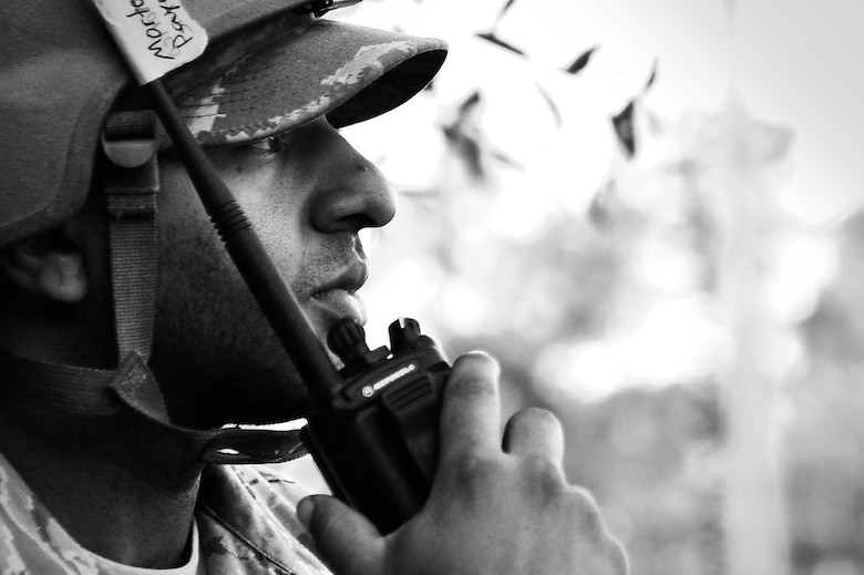 U.S. Air Force Staff Sgt. Michael Payne, 20th Civil Engineer Squadron construction management technician, talks on a radio during operational readiness exercise Weasel Victory 17-07 at Poinsett Electronic Combat Range, near Wedgefield, S.C., May 16, 2017. Various Airmen across the Poinsett site utilized radios to receive information on simulated attacks or condition changes throughout the three-day, 72-hour exercise. (U.S. Air Force photo by Airman 1st Class Christopher Maldonado)