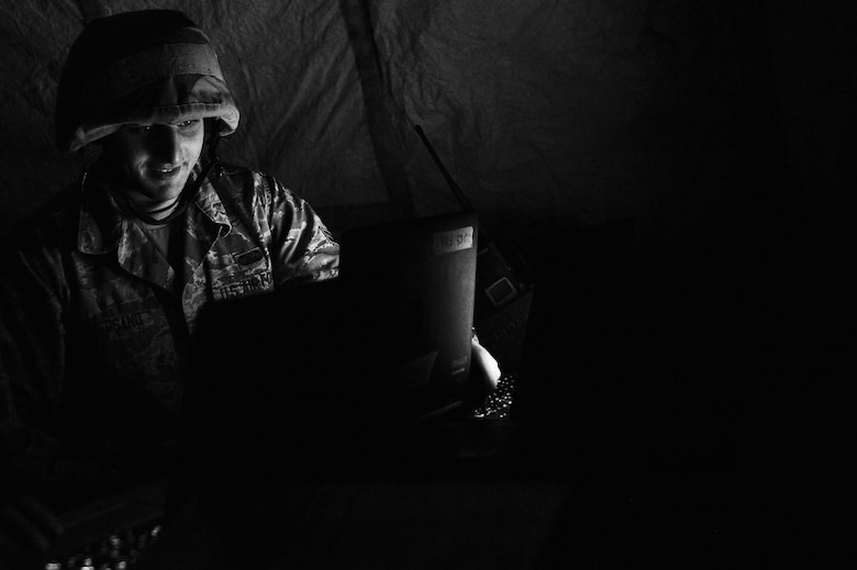 U.S. Air Force Airman 1st Class Jared Aversano, 20th Communications Squadron client systems technician, works on a laptop following a simulated power outage during operational readiness exercise Weasel Victory 17-07 at Poinsett Electronic Combat Range, near Wedgefield S.C., May 16, 2017. Airmen endured conditions such as power outages in order to evaluate how they react to unplanned scenarios that may arise in a deployed environment.  (U.S. Air Force photo by Airman 1st Class Christopher Maldonado)
