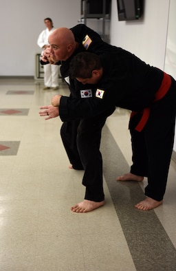 Douglas Mase, martial arts instructor, demonstrates Asian traditional martial arts during the Asian-American and Pacific-Islander observation day at the Taylor Chapel on Goodfellow Air Force Base, Texas, May 23, 2017. Mase described the origin and differences of various arts such as Aikido, Tang Soo Do and Kung Fu. (U.S. Air Force photo by Airman 1st Class Caelynn Ferguson/Released)
