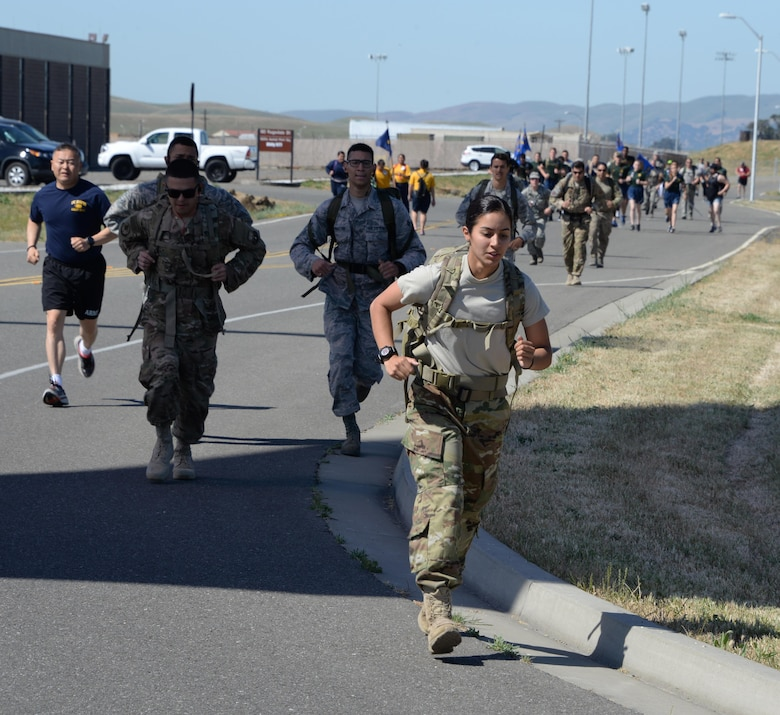 Military members and their families participate in the 7th Annual Gold Star Families Ruck March May 20, 2017 at Travis Air Force Base, Calif. The event, which featured 275 participants, is held every year by the Travis First Sergeant's Council to support Gold Star Families. (U.S. Air Force photo/Tech. Sgt. James Hodgman)