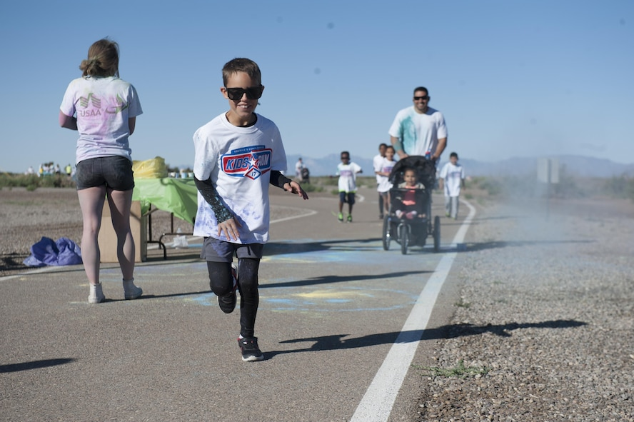 The Youth and Teen Center hosted the Art Blast color run 5K and the America's Armed Forces Kids fun run at Holloman Air Force Base, N.M on May 20, 2017. During the run, younger children run a half mile, seven and eight year olds run one mile, and the older children run two miles. (U.S. Air Force photo by Airman 1st Class Ilyana A. Escalona)