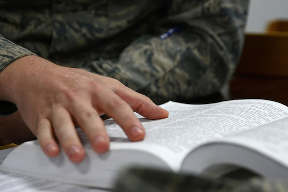 U.S. Air Force Senior Airman Quest Largent, 20th Fighter Wing Judge Advocate (JA) military justice paralegal, reads from a courts-martial manual at Shaw Air Force Base, S.C., May 9, 2017. The manual details punitive articles individuals can be charged under and provides JA Airmen information on how to write the charges. (U.S. Air Force photo by Airman 1st Class Kathryn R.C. Reaves)