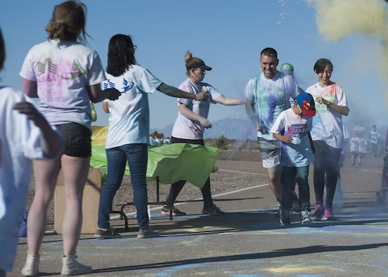 The Youth and Teen Center hosted the Art Blast color run 5K and the America's Armed Forces Kids fun run at Holloman Air Force Base, N.M on May 20, 2017. During the run, volunteers set up tables along the track with various colored paint powder to toss at the runners transforming their fresh white shirts into a colorful canvas. (U.S. Air Force photo by Airman 1st Class Ilyana A. Escalona)