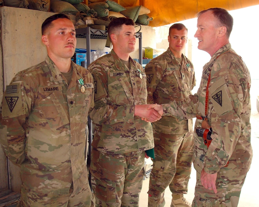 Col. Robert Suter, commander, 3rd Medical Command (Deployment Support) Forward, presents awards to Soldiers of the Forward Surgical Team at Forward Operating Base Dwyer, Helmand Province, Afghanistan, March 22, 2017. Sutter was conducting battlefield circulation to recognize U.S. Army Central Soldiers performance.