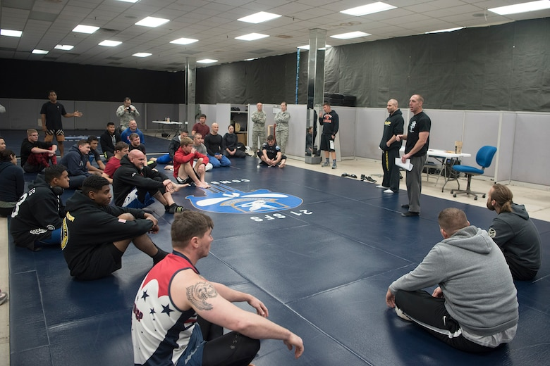 PETERSON AIR FORCE BASE, Colo. – Team Pete Airmen receive a safety briefing before a combatives tournament for National Police Week, May 18, 2017, at Peterson Air Force Base, Colo. The combatives tournament was one of several events the 21st Security Forces Squadron hosted for Police Week, May 15-19, including a distracted driving simulator, obstacle course, and BBQ. (U.S. Air Force photo by Steve Kotecki)