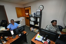 U.S. Air Force Tech. Sgt. Deonna Johnson, 20th Dental Squadron (DS) records and reception noncommissioned officer in charge, right, templates and sends out record requests while Beverly Ross, 20th DS active duty dental program referral manager, works on referrals at Shaw Air Force Base, S.C., May 18, 2017. Part of the dental support flight, Johnson acts as a liaison between the 20th DS and unit deployment managers, ensuring annual appointments are scheduled for every service member. Ross is responsible for all dental referrals to off-base clinics, ensuring Team Shaw members get the care they need. (U.S. Air Force photo by Airman 1st Class Destinee Sweeney)