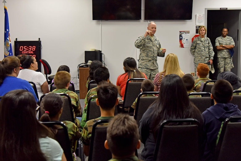U.S. Air Force Col. Michael Downs, 17th Training Wing commander, briefs children for Operation: Kids Investigating Deployed Services at the Vance Deployment Center on Goodfellow Air Force Base, Texas, May 20, 2017. Operation: K.I.D.S. simulated a deployment and gave children a joint environment exposure. (U.S. Air Force photo by Staff Sgt. Joshua Edwards/Released)