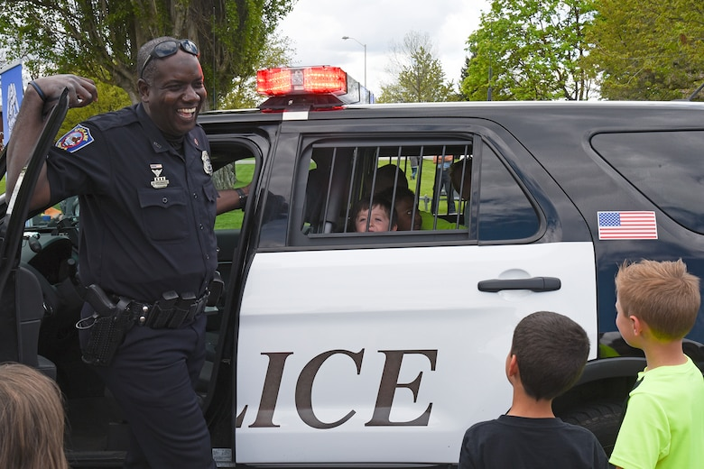 City of Spokane Police Department Officer Ken Applewhaite shows Michael Anderson Elementary students the inside of a patrol vehicle during the National Police Week Law Enforcement Exposition May 18, 2017, at Fairchild Air Force Base, Washington. The 92nd Security Forces Squadron hosted numerous events for Team Fairchild and their families to enjoy, including the expo which featured an obstacle course, scavenger hunt and Military Working Dog demonstrations. (U.S. Air Force photo/Senior Airman Mackenzie Richardson)