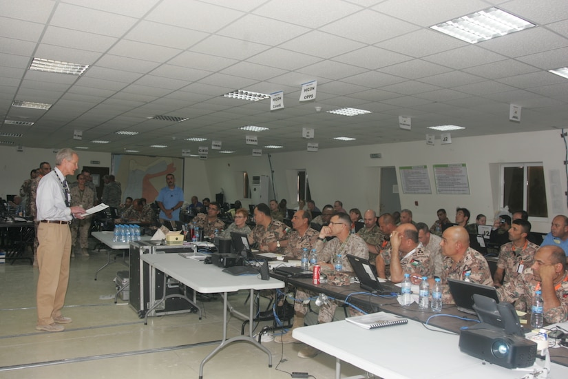 Mr. Nick Conner, U.S. contractor, conducts indoctrination training as the political adviser to staff elements of Combined Forces Headquarters prior to the start of the exercise, May 6, at the Joint Training Center in Jordan. Eager Lion 2017 is an annual U.S. Central Command exercise in Jordan designed to strengthen military-to-military relationships between the U.S., Jordan and other international partners. This year's iteration is comprised of about 7,200 military personnel from more than 20 nations that will respond to scenarios involving border security, command and control, cyber defense and battlespace management.  (Photo by Moath Aleen, Jordanian Army).