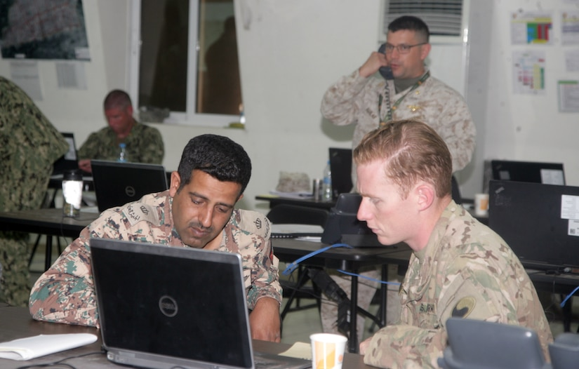 Maj. Salah Al-Ssheem, left, Jordanian infantry officer, and U.S. Army Capt. Herrick Johnson, 29th Infantry Division infantry officer, discussing a translation application during exercise Eager Lion, May 15, at the Joint Training Center in Jordan. Eager Lion 2017 is an annual U.S. Central Command exercise in Jordan designed to strengthen military-to-military relationships between the U.S., Jordan and other international partners. This year's iteration is comprised of about 7,200 military personnel from more than 20 nations that will respond to scenarios involving border security, command and control, cyber defense and battlespace management.  (Photo by Moath Aleen, Jordanian Army).