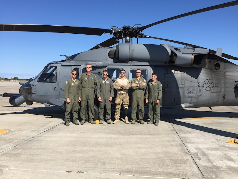 Staff Sgt. August O'Niell (center), pararescueman, and his Air Force Reserve Wingmen, an HH-60G Pave Hawk helicopter crew, reunited for the first time in June 2016 after the team embarked on a 2011 deployment to save lives when O'Niell was shot through both legs during a combat rescue mission in Afghanistan. O'Niell is the only single amputee pararescueman actively serving in the U.S. Air Force. (U.S. Air Force photo SrA Brandon Kalloo Sanes)