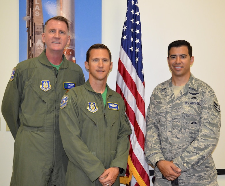 Staff Sgt. August O'Niell, (right), pararescueman, and his wingmen, Maj. Paul Carpenter (center), HH-60G Pave Hawk helicopter instructor pilot, and Chief Master Sgt. Randolph Wells, special mission aviation superintendent, gave a presentation on resiliency to 45th Space Wing and Air Force Technical Applications Center Airmen May 19 and 22. The three embarked on a 2011 deployment to save lives when O'Niell was shot through both legs during a combat rescue mission in Afghanistan. (U.S. Air Force photo SrA Brandon Kalloo Sanes)