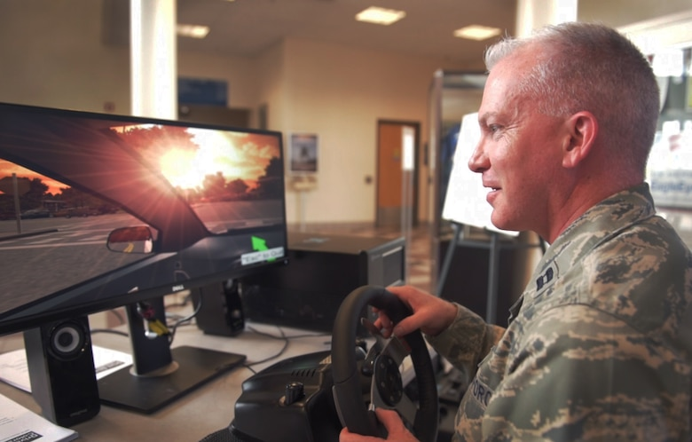 PETERSON AIR FORCE BASE, Colo. – Capt. John Boulware, 21st Space Wing chaplain, participates in a distracting driving simulator, May 17, 2017, at Peterson Air Force Base, Colo. Hosted by the 21st Security Forces Squadron, the program offers the driver a simulated experience on what it is like to drive with various distractions. The distracted driving simulator is one of several events by the 21st SFS for National Police Week including an obstacle course, combative tournament, BBQ and golf tournament. (U.S. Air Force photo by David Meade)