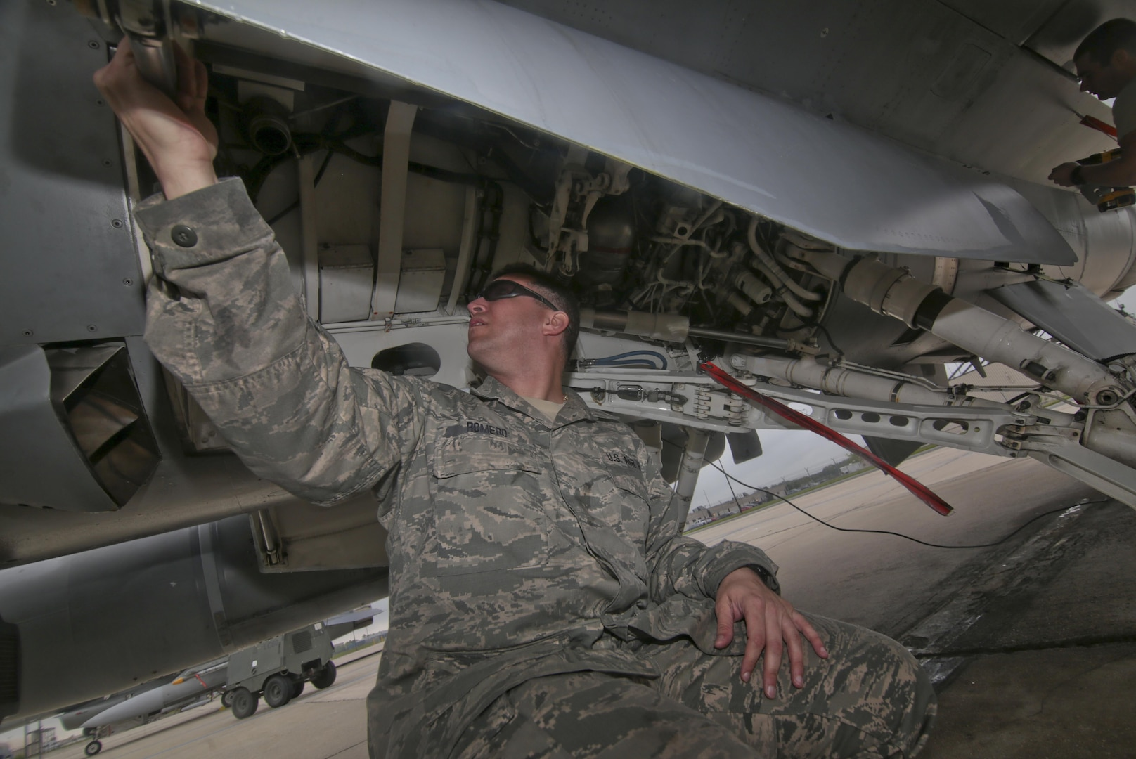 New Jersey Air National Guard Tech. Sgt. Sean Romero from the 177th Aircraft Maintenance Squadron looks over an F-16D Fighting Falcon during a three-day Aeropsace Control Alert CrossTell live-fly training exercise at Atlantic City Air National Guard Base, N.J., May 23, 2017. Representatives from Air National Guard fighter wings, Civil Air Patrol, and U.S. Coast Guard rotary-wing air intercept units will conduct daily sorties from May 23-25 to hone their skills with tactical-level air-intercept procedures. (U.S. Air National Guard photo by Master Sgt. Matt Hecht/Released)