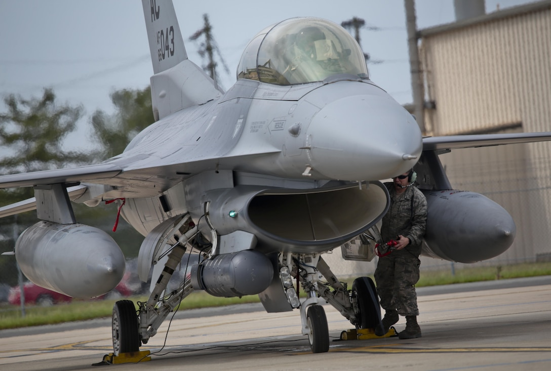 New Jersey Air National Guard Tech. Sgt. Sean Romero, an F-16 crew chief, communicates with Col. Bradford Everman, 119th Fighter Squadron Commander, while preparing his F-16D Fighting Falcon for a flight during a three-day Aeropsace Control Alert CrossTell live-fly training exercise at Atlantic City Air National Guard Base, N.J., May 23, 2017. Representatives from the Air National Guard fighter wings, Civil Air Patrol, and U.S. Coast Guard rotary-wing air intercept units will conduct daily sorties from May 23-25 to hone their skills with tactical-level air-intercept procedures. (U.S. Air National Guard photo by Master Sgt. Matt Hecht/Released)