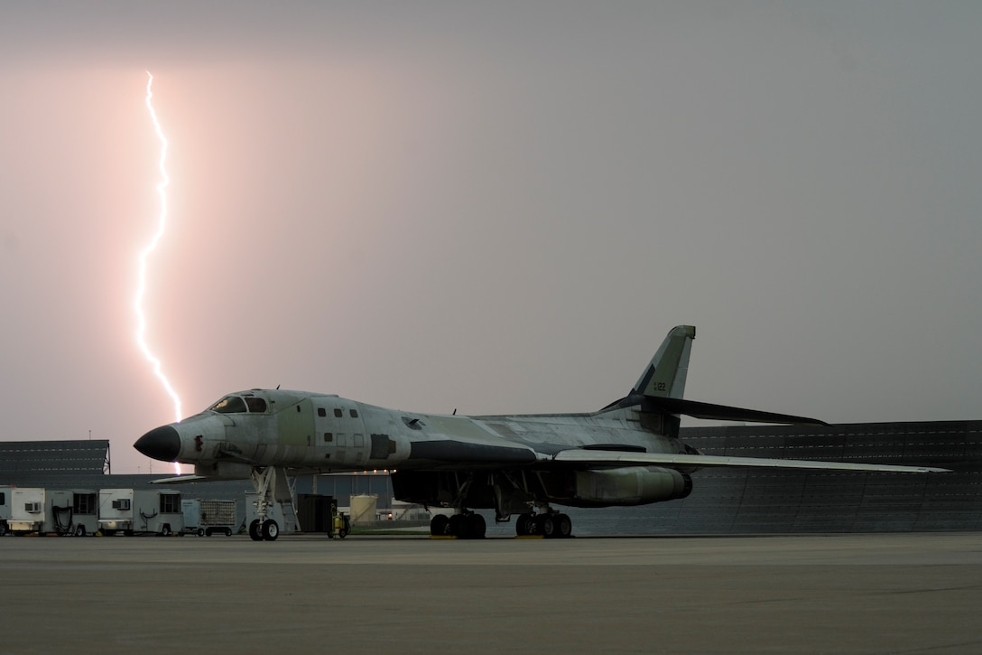 Lightning strikes behind a B-1B Lancer parked on the flight line as a major storm approaches Tinker Air Force Base, Oklahoma May 18, 2017. The B-1B is at Tinker undergoing depot level maintenance and has been stripped of a majority of its paint. (U.S. Air Force photo/Greg L. Davis)