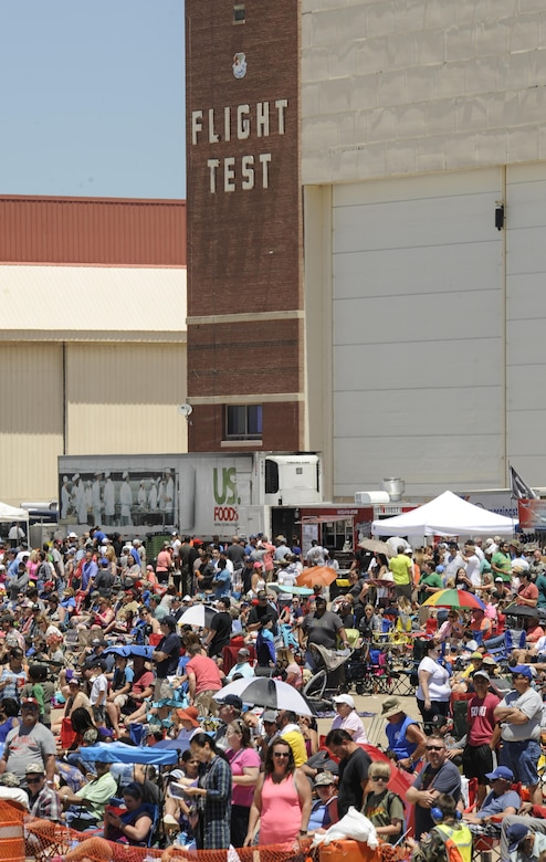 A massive crowd and food booths are shown in front of the large hangar which is home to the 10th Flight Test Squadron, Air Force Reserve Command, during Tinker's Star Spangled Salute air show May 21, 2017, Tinker Air Force Base, Oklahoma. The Saturday crowd topped 100,000 people to set an attendance record. (U.S. Air Force photo/Greg L. Davis)