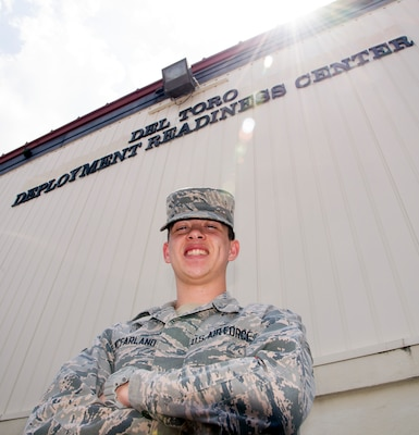Airman Ethan McFarland, 502nd Logistics Readiness Squadron logistics planner, poses in front of the Del Toro Deployment Readiness Center at Joint Base San Antonio-Randolph, May 23, 2017. McFarland is a wing deployment coordinator for Joint Base San Antonio-Fort Sam Houston and JBSA-Randolph. As a deployment coordinator, he deploys personnel and cargo to places all around the world.