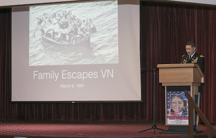 Lt. Col. Lan Dalat shares his family's story of escape from Vietnam with an audience of community members May 18, 2017 for the Asian American Pacific Islander Heritage Month Observance at Camp Zama Community Club.