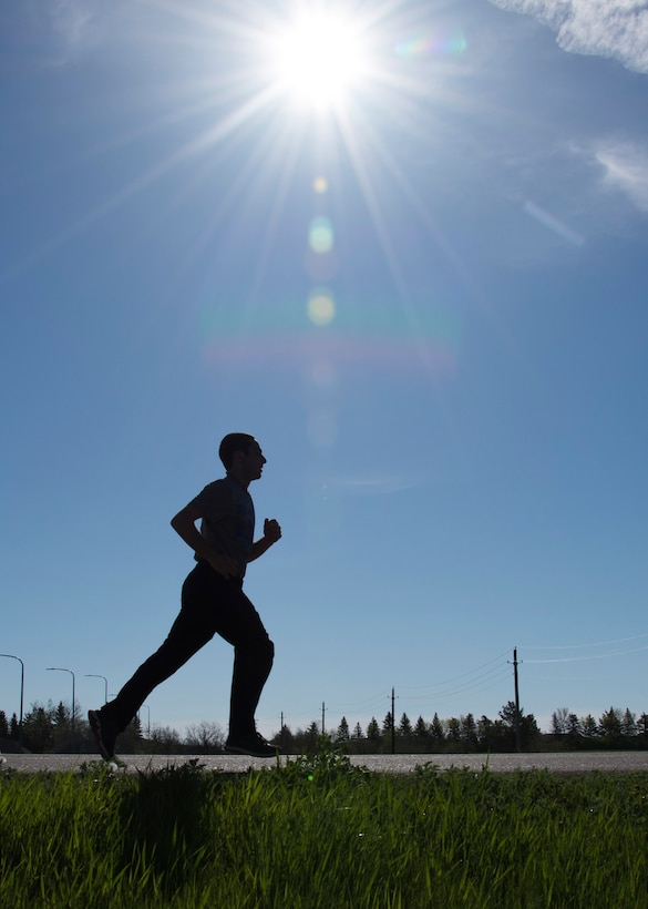 An Airman participates in the 5K Memorial Run during National Police Week at Minot Air Force Base, N.D., May 18, 2017. Base personnel, local law enforcement and their families were invited to participate in the run in honor of currently serving law enforcement personnel. (U.S. Air Force photo/Airman 1st Class Alyssa M. Akers)
