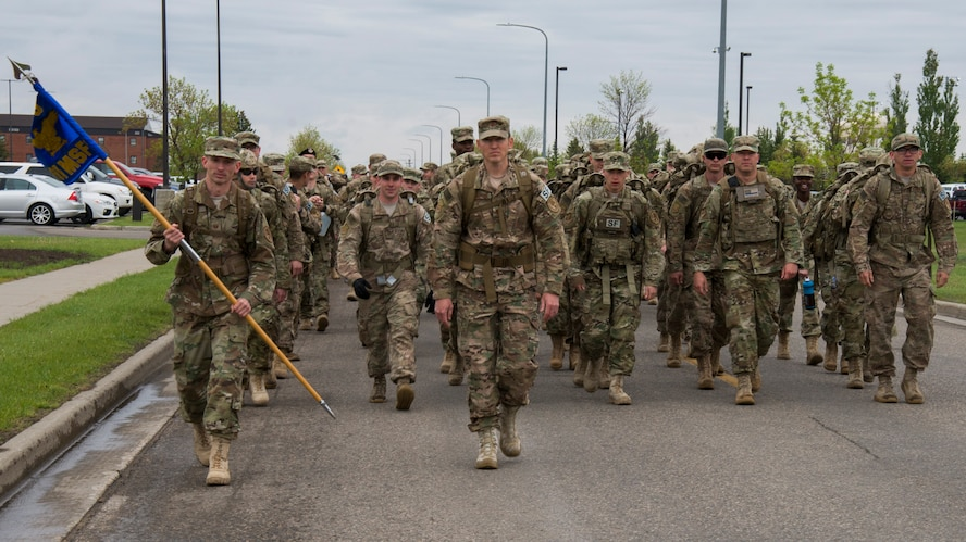 Airmen with the 91st Security Forces Group begin a 5K Remembrance Ruck March in honor of National Police Week at Minot Air Force Base, N.D., May 16, 2017. Base personnel and local law enforcement were invited to participate in the march to honor fallen law enforcement personnel. (U.S. Air Force photo/Airman 1st Class Alyssa M. Akers)