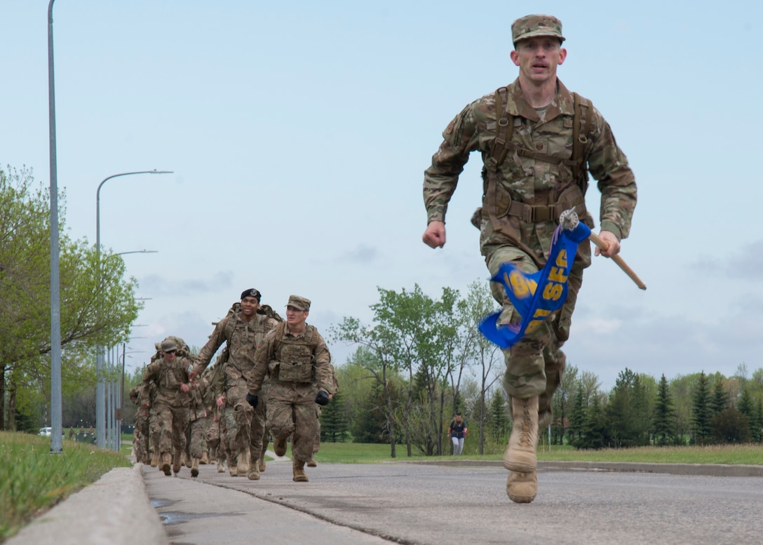 Master Sgt. Christopher Davis, 791st Missile Security Forces Squadron first sergeant, sprints to finish the 5K Remembrance Ruck March at Minot Air Force Base, N.D., May 16, 2017. Members who finished first turned around to motivate the group to finish strong together. (U.S. Air Force photo/Airman 1st Class Alyssa M. Akers)