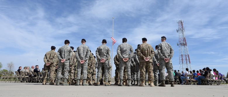 Airmen with the 5th Security Forces Squadron stand at parade rest during the National Police Week retreat ceremony at Minot Air Force Base, N.D., May 19, 2017. During National Police Week, many ceremonies, competitions and demonstrations are held by law enforcement organizations for ceremonial reasons, patriotic tributes and public viewing. (U.S. Air Force photo/Airman 1st Class Austin M. Thomas)