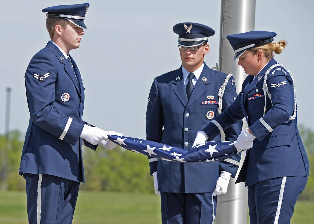 Minot Air Force Base, N.D., Honor Guard Airmen fold the flag during the National Police Week retreat ceremony May 19, 2017. A retreat ceremony is the daily military practice of lowering the flag. (U.S. Air Force photo/Airman 1st Class Austin M. Thomas)