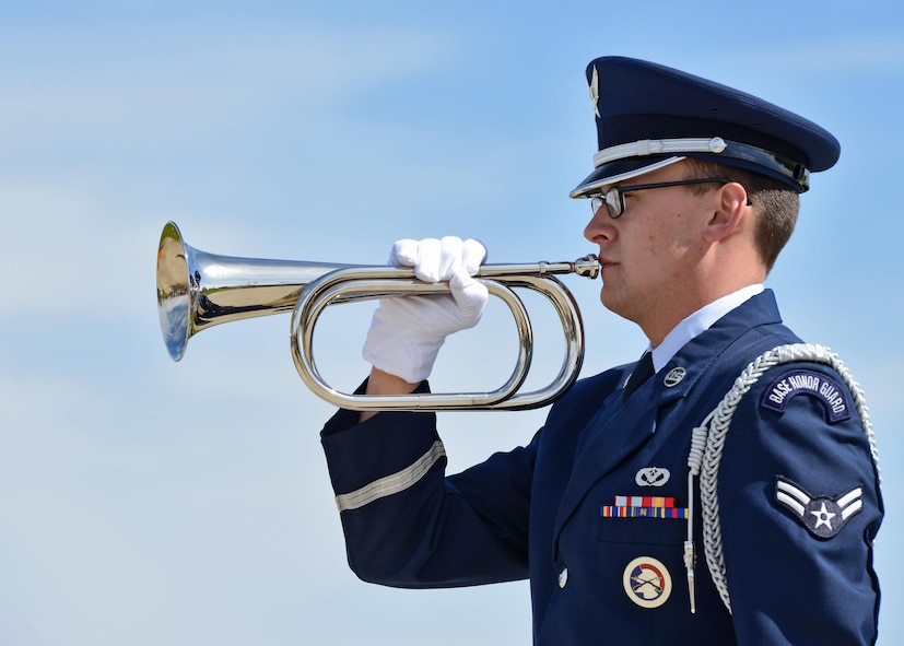 Airman 1st Class Douglas Newton, 5th Civil Engineer Squadron structural apprentice, plays the trumpet during a National Police Week retreat ceremony at Minot Air Force Base, N.D., May 19, 2017. National Police Week honors law enforcement personnel around the world who have made the ultimate sacrifice. (U.S. Air Force photo/Airman 1st Class Austin M. Thomas)
