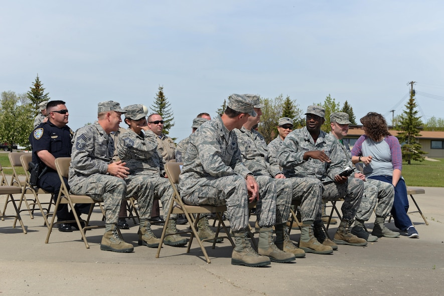 Base leadership, Airmen and local police officers sit during the National Police Week retreat ceremony at Minot Air Force Base, N.D., May 19, 2017. National Police Week honors law enforcement personnel around the world who have made the ultimate sacrifice. (U.S. Air Force photo/Airman 1st Class Austin M. Thomas)