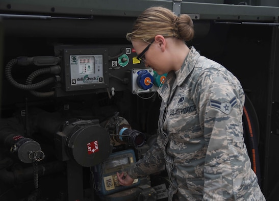 Airman 1st Class Kaitlin Reynolds, 22nd Logistics Readiness Squadron Fuels Distributions technician, checks gauges on a fuels truck May 11, 2017, at McConnell Air Force Base, Kan. The fuels flight is responsible for receiving, issuing, maintaining, storing and testing all aviation and ground-product fuels that come into the base for every aircraft and vehicle. (U.S. Air Force photo/Airman 1st Class Erin McClellan)