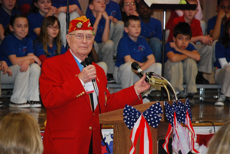 "Hershel ""Woody"" Williams, an Iwo Jima Medal of Honor recipient, speaks during the Iwo Jima Survivors Reunion Luncheon at Sheppard Elementary School on February 19, 2010. The students honored the veterans with a musical tribute after the luncheon. (Courtesy photo)"