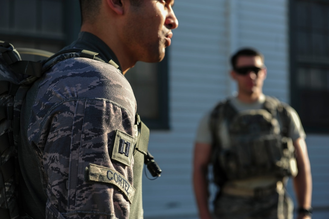 Capt. Joseph Cortez, Joint Base Security Forces (JBSF) operations officer, speaks to the JBSF Airmen before the Police Week Ruck March, on Joint Base Pearl Harbor-Hickam, Hawaii, May 19, 2019. According to the National Peace Officer's Memorial Fund website, National Police Week was established in 1962 by President John F. Kennedy to pay tribute to law enforcement officers who lost their lives in the line of duty. Ceremonies and observances are held annually throughout the U.S. in remembrance of fallen officers.  (U.S. Air Force photo by Tech. Sgt. Heather Redman)