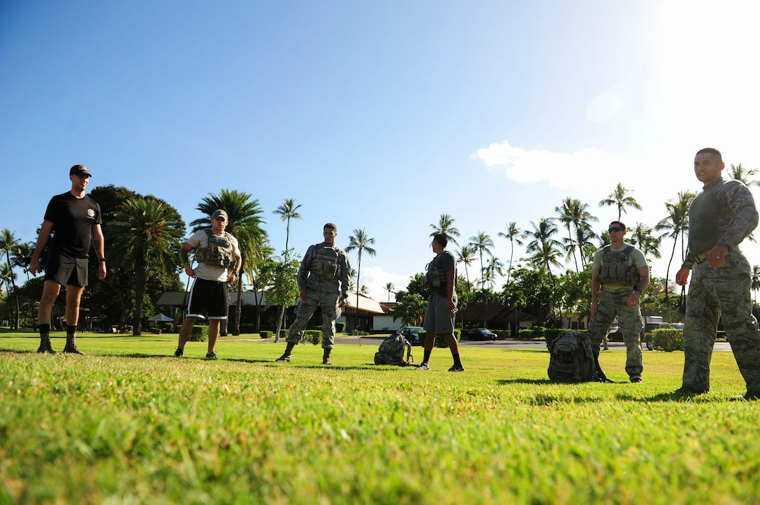 Joint Base Security Forces (JBSF) Airmen participate in circuit training workouts during the Police Week Ruck March, on Joint Base Pearl Harbor-Hickam, Hawaii, May 19, 2019.   According to the National Peace Officer's Memorial Fund website, National Police Week was established in 1962 by President John F. Kennedy to pay tribute to law enforcement officers who lost their lives in the line of duty. Ceremonies and observances are held annually throughout the U.S. in remembrance of fallen officers.  (U.S. Air Force photo by Tech. Sgt. Heather Redman)