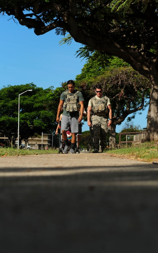 Joint Base Security Forces (JBSF) Airmen march around Hickam Field during the Police Week Ruck March, on Joint Base Pearl Harbor-Hickam, Hawaii, May 19, 2019. According to the National Peace Officer's Memorial Fund website, National Police Week was established in 1962 by President John F. Kennedy to pay tribute to law enforcement officers who lost their lives in the line of duty. Ceremonies and observances are held annually throughout the U.S. in remembrance of fallen officers.  (U.S. Air Force photo by Tech. Sgt. Heather Redman)