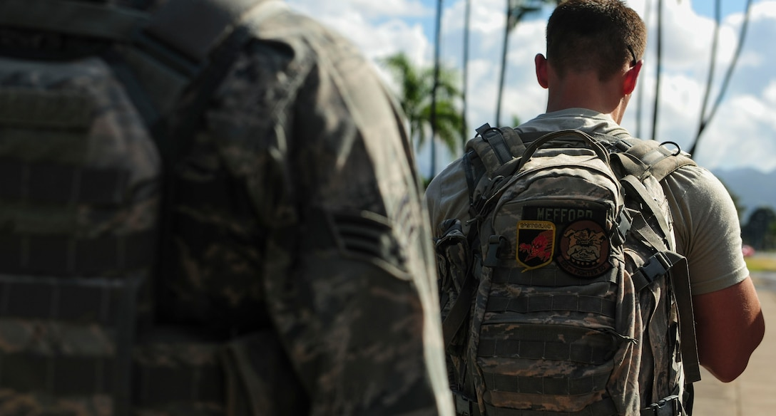 Senior Airman Scott Mefford, Joint Base Security Forces (JBSF) police services clerk, marches around Hickam Field during the Police Week Ruck March, on Joint Base Pearl Harbor-Hickam, Hawaii, May 19, 2019. According to the National Peace Officer's Memorial Fund website, National Police Week was established in 1962 by President John F. Kennedy to pay tribute to law enforcement officers who lost their lives in the line of duty. Ceremonies and observances are held annually throughout the U.S. in remembrance of fallen officers.  (U.S. Air Force photo by Tech. Sgt. Heather Redman)
