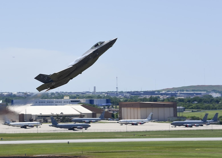 An F-35A Lightning II takes flight during the 2017 Star Spangled Salute air show at Tinker AFB May 21.  The joint strike fighter was one of more than 50 statics and aerial acts on display for the air show as record crowds helped Tinker celebrate its 75th anniversary as well as the Air Force 70th birthday.  (U.S. Air Force photo/Mark Hybers)