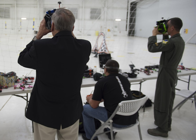 Retired Gen. John Jumper, former U.S. Air Force chief of staff, and Col. Houston Cantwell, 49th Wing commander, participate in a virtual drone racing demo on Holloman Air Force Base, N.M., May 19, 2017. During his visit he was updated on current Remotely Piloted Aircraft training, given a look into the possibilities of future unmanned aircraft technology, and a virtual drone racing obstacle course demonstration. Jumper is most known within the RPA community for his work arming the MQ-1 Predator. (U.S. Air Force Photo by Senior Airman Chase Cannon)