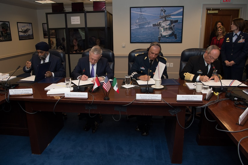 Defense Secretary Jim Mattis signs a joint statement with other defense leaders after hosting the third North American Defense Ministerial meeting at the Pentagon, May 22, 2017. From left to right are Canadian Defense Minister Harjit Sajjan, Mattis, Mexican Defense Secretary Gen. Cienfuegos Zepedas and Mexico's secretary of navy, Adm. Vidal Soberón. DoD photo by Army Sgt. Amber I. Smith