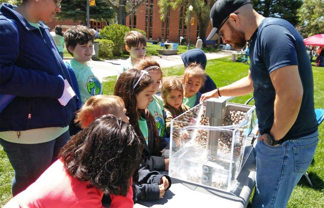 TRINIDAD, COLO. – District employee Jesse Gutierrez points out one of the dams features to students attending the 6th Annual Trinidad Water Festival, May 18, 2017