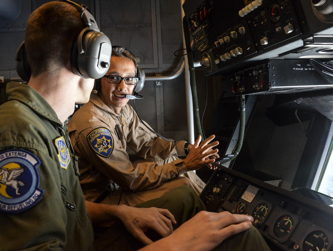 Members of the California Highway Patrol fly with aircrew from the 6th and 9th Air Refueling Squadrons May 11 at Travis Air Force Base, California. The CHP joined the aircrew on a KC-10 Extender training flight, where they were able to watch air refueling and learn more about the base mission. (U.S. Air Force photo / 2nd Lt. Sarah Johnson)