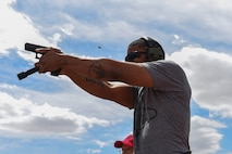 Staff Sgt. Clifford fires his weapon at Station Four during the Nellis/Creech Law Enforcement Pistol Shoot as part of Police Week May 15, 2016, at Silver Flag Alpha, Nev. National Police Week takes place annually to honor the service and sacrifice of civilian and military law enforcement members. (U.S. Air Force photo Airman 1st Class Adarius Petty)