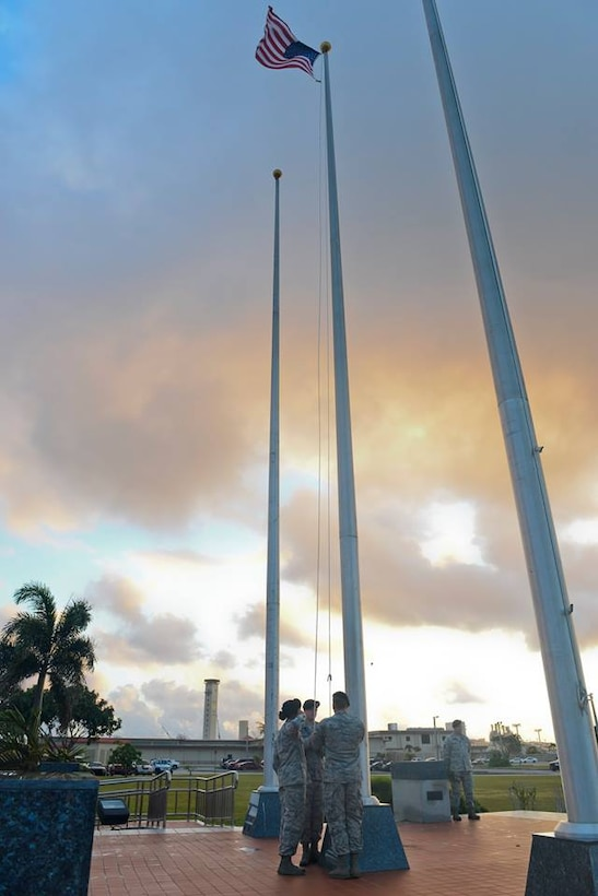 Airmen assigned to the 36th Security Forces Squadron raise the American flag during a National Police Week ceremony May 19, 2017, at Andersen Air Force Base, Guam. The ceremony was the last event of National Police Week, honoring the service and sacrifice of law enforcement officers who have lost their lives in the line of duty. (U.S Air Force photo by Airman 1st Class Christopher Quail)